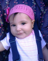 Baby girl with pink hat.PNG