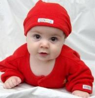adorable baby in bright red outfit.jpg