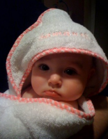 Baby wrapped in baby towel.PNG