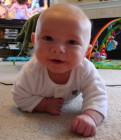 Baby boy crawling closer and closer to the camera.PNG