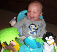 Baby playtime ideas_happy baby boy playing.PNG