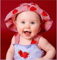 cute baby wearing her strawberry hat.jpg