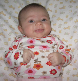 Cute baby girls pictures_she looks so adorable with her light smile and looking straight at the camera.PNG