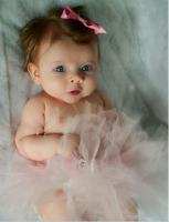 Pretty baby girl in her beautiful ballet outfit and she has the most beautiful eyes.JPG