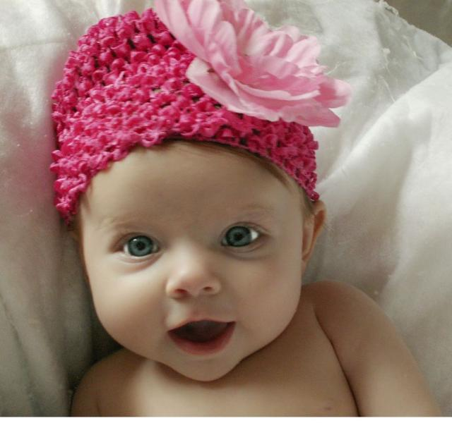 Pretty baby girl with her beautiful pink floral hat.JPG
