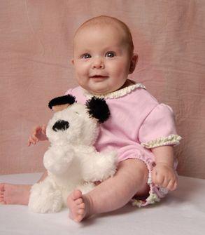 Photograph of pretty baby girl w/ her teddy bear