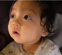 Close up picture of beautiful Asian toddler girl with her pretty hair.JPG