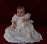 Baby girl in her beautiful white dress.PNG
