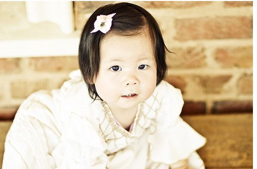 picture of an Asian baby girl dressing up.JPG