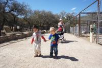 Darwin the 2 and a half year old toddler holds friend Ray's hand at the Austin Zoo.jpg