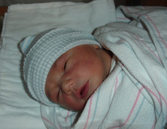 Image of newborn baby sleeping looking so cute and adorable.PNG