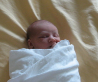 Newborn baby photo wrapped in white.PNG
