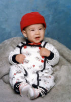 Cute Asian baby with red hat.PNG