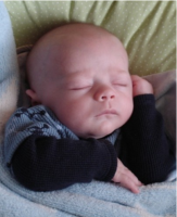 Funny looking sleepy baby boy_very cute.PNG