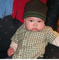 Cute and serious looking baby boy photos.PNG
