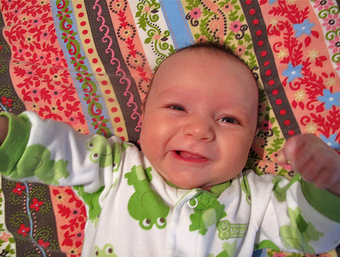 cute baby smiling to the camera with elvis mouth expression.PNG