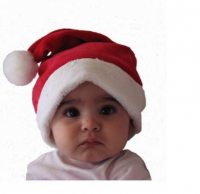 Cute baby wearing a santa hat.PNG