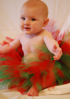 Image of baby in ballet outfit in red and dark green.PNG