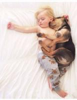 Kids and puppy sleeping comfortablely together.JPG