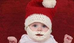 Cute Baby wearing unique Santa winter hat with face cover.JPG