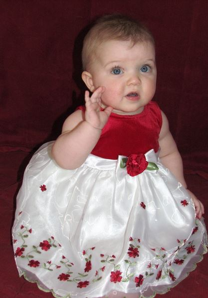 Baby girl first Christmas picture in her beautiful pretty xmas dress.JPG