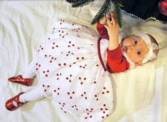 Baby girl xmas picture in her beautiful white and red dress.JPG