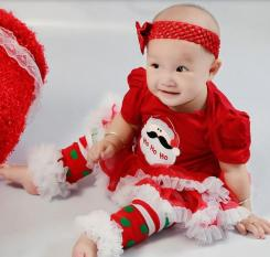 Cute baby girl in her Christmas leg warmers.JPG