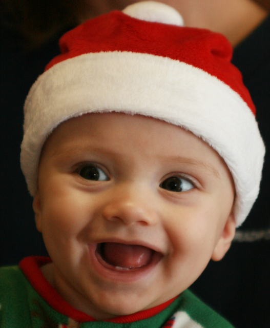 smiling baby wear small cute christmas hat.PNG