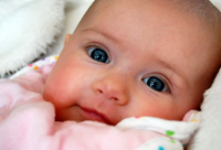 Close up picture of beautiful baby girl with pretty blue eyes.PNG