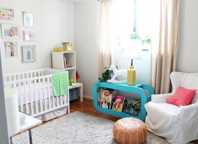 Cute modern nursery perfect for baby boys with white walls and furniture and a touch of bright colors.JPG