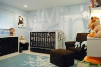 Blue and brown nursery with cool wall paper