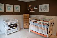 Brown wall nursery with white nursery furniture