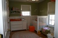 Baby girls nursery with green paint and white furniture gives a clean chic look with a natural touch.JPG