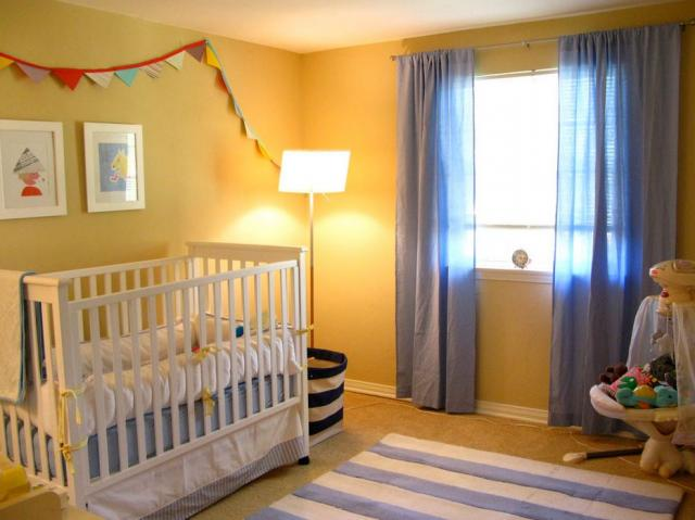 Yellow nursery with white furniture and blue baby  boys theme
