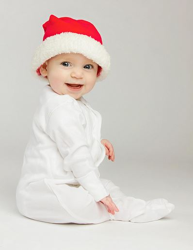 Simple yet very cute baby Christmas photo shoot with baby in white and santa hat.JPG