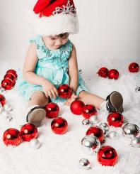 Adorable Christmas photo shoot  with toddler girl in her beautiful dress.JPG