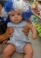 baby with clown wig in white and blue.PNG