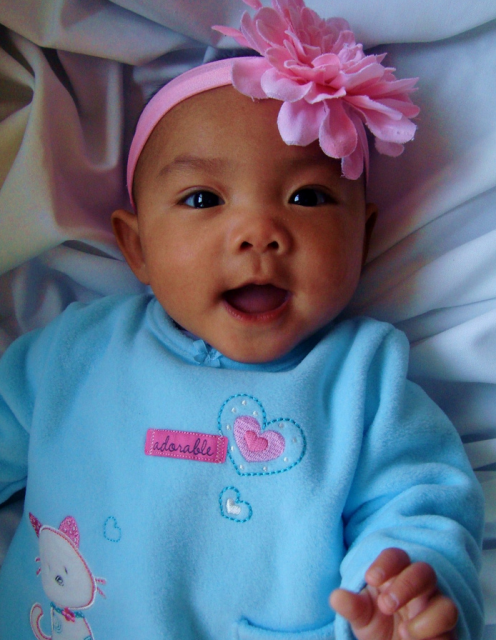 Cute baby girl with big pink floral headband.PNG