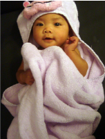 Picture of baby girl wrapped in light pink towl.PNG