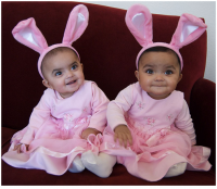 Cute Indian twin girls in pink Easter outfit.PNG