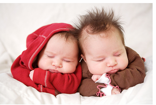 Image of twin girls with spiky hairstyles.PNG