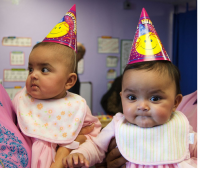 Picture of Indian twins baby girls celebrating their birthday.PNG