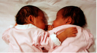 Picture of twin girl sleeping.PNG