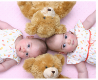 Pretty twin girl babies with twin teddy bears.PNG
