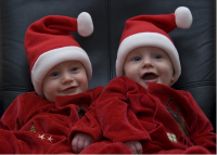 Twin babies in christmas outfits picture.PNG