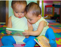 Twins baby girls studing hard.PNG