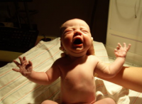 Photo of newborn baby under the light.PNG