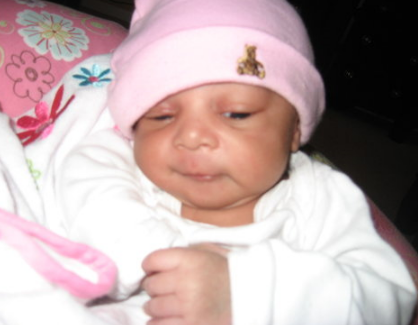 Black newborn baby girl looking so adorable png