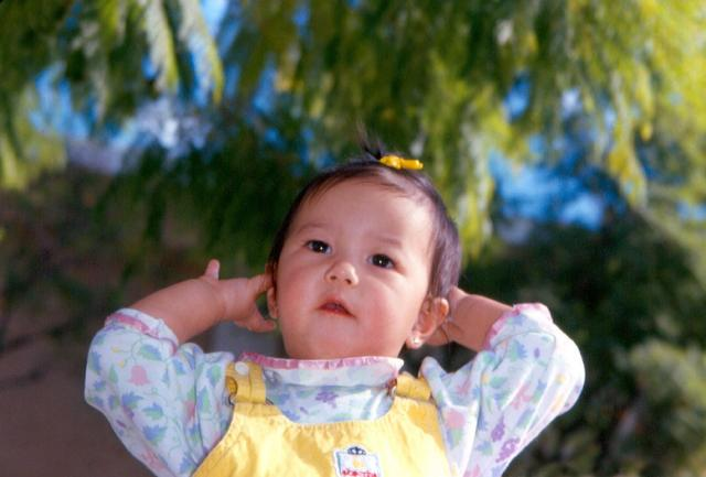 Asian baby girl making a post for the camera.jpg