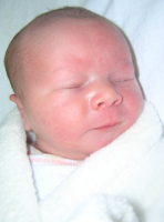 Newborn baby face picture close up.PNG